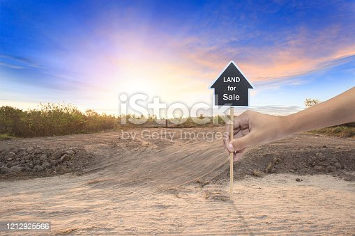 istock Empty dry cracked swamp reclamation soil, land plot for housing construction project with car tire print in rural area and beautiful blue sky with fresh air Land for sales landscape concept 1212925566
