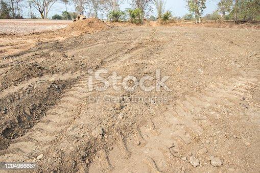 istock Empty dry cracked swamp reclamation soil, 1204966667