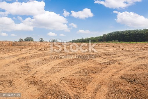 istock Empty dry cracked swamp reclamation soil, 1216087127