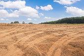 istock Empty dry cracked swamp reclamation soil, 1216087127