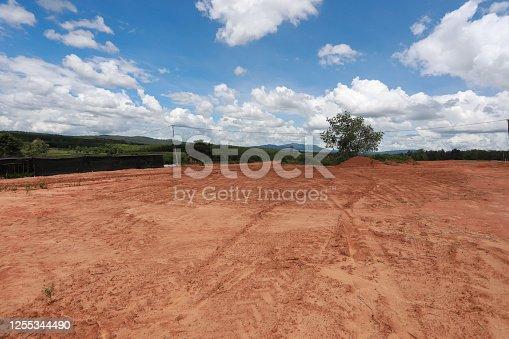 istock Empty dry cracked swamp reclamation soil, 1255344490
