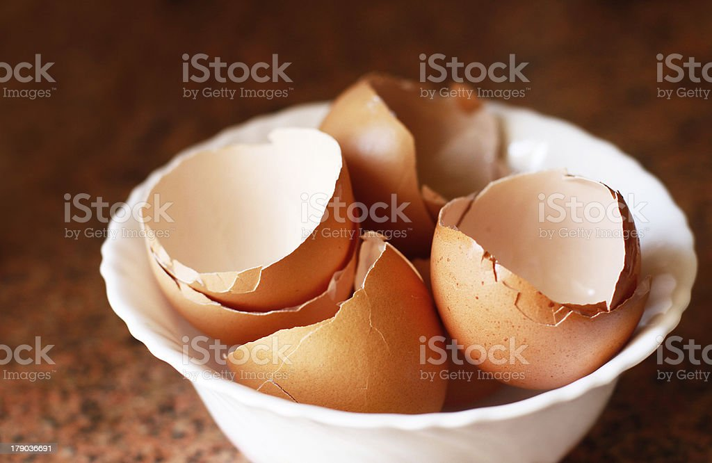 Empty eggshell in a white bowl royalty-free stock photo