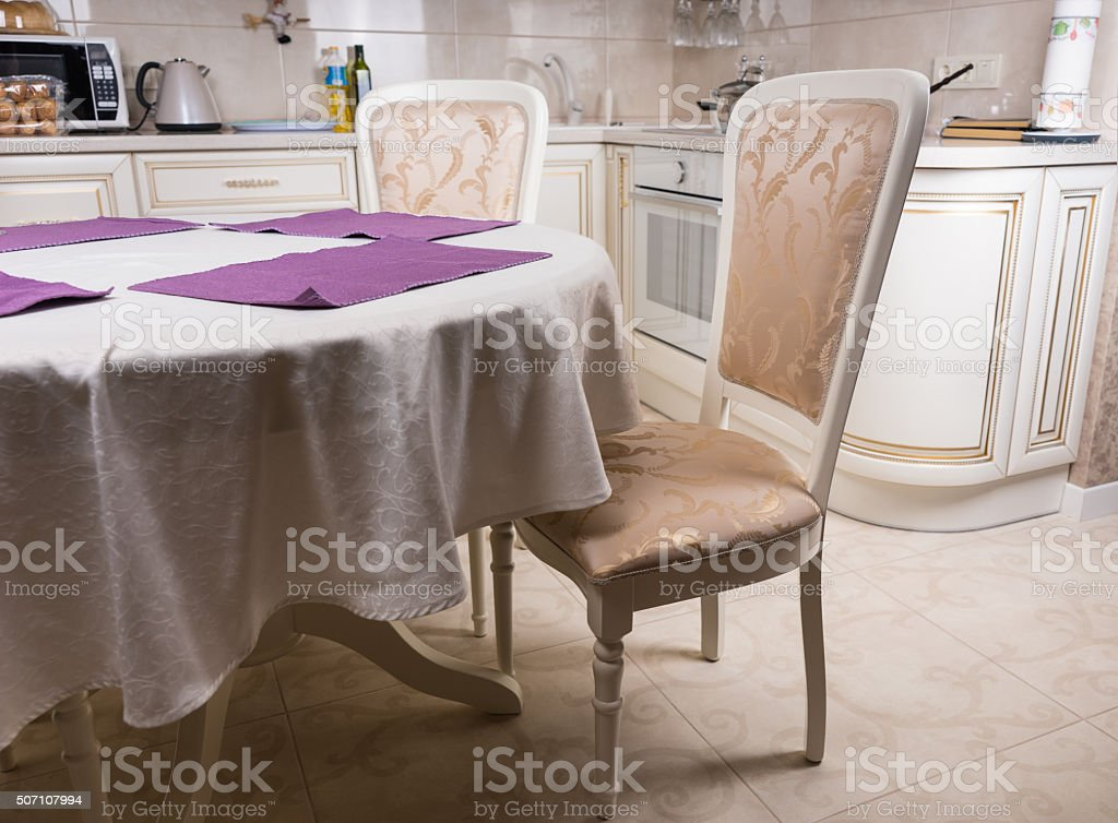 Empty Elegant Table and Chairs in Kitchen stock photo