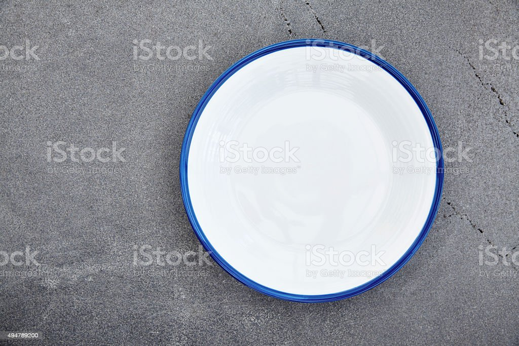 Empty enamel plate stock photo