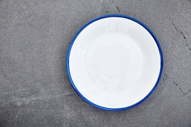 empty enamel plate - enamel stock photos and pictures