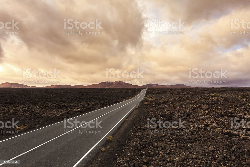 Empty endless road leading into martian landscape stock photo