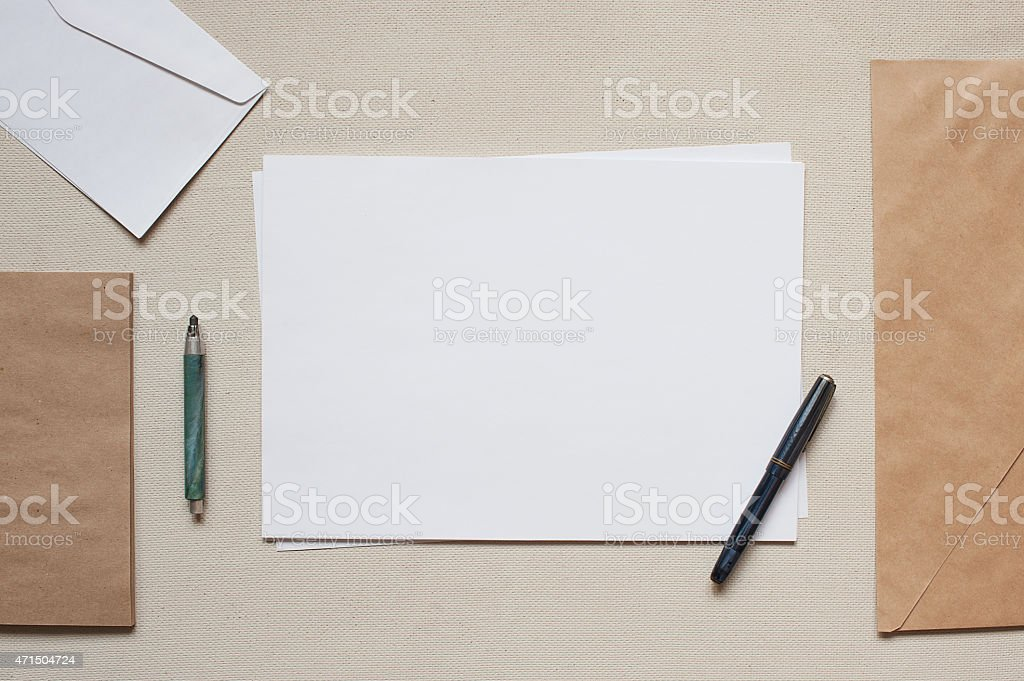 Empty envelopes and sheets of paper on the table stock photo