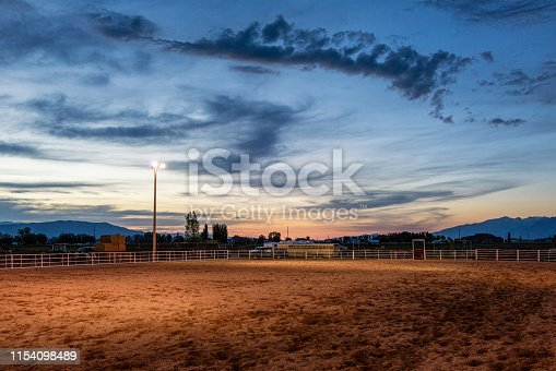 Floodlights illuminating an empty equestrian arena in the USA.