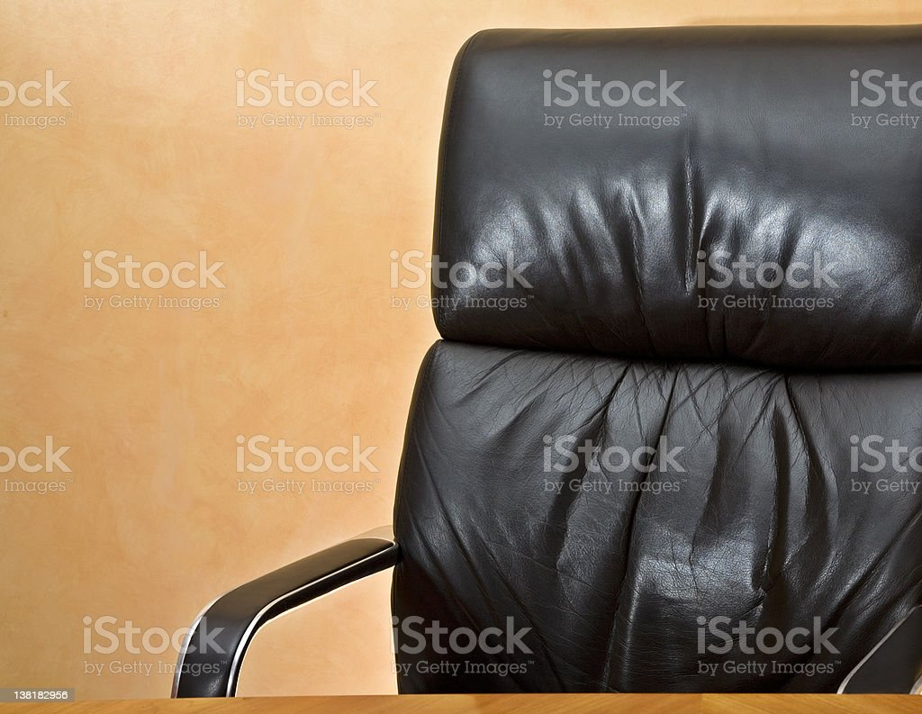 Empty executive chair and desk with copyspace royalty-free stock photo