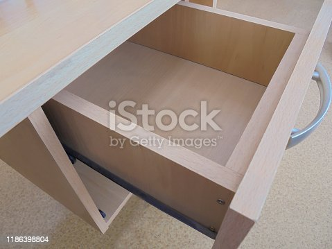 empty extended open top drawer with metal table handle for office