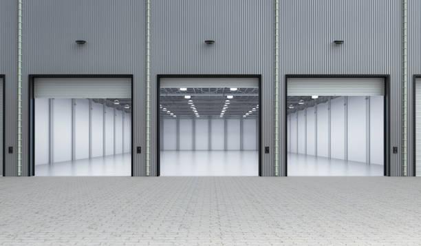 leere fabrik innen - garagentor mit tür stock-fotos und bilder