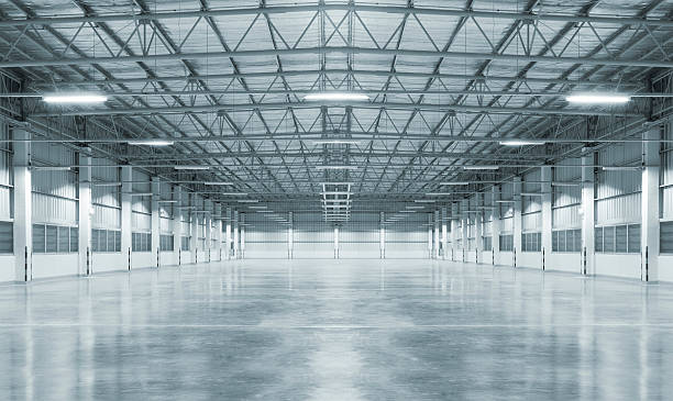 Empty factory Empty factory with concrete floor, night scene. warehouse interior stock pictures, royalty-free photos & images