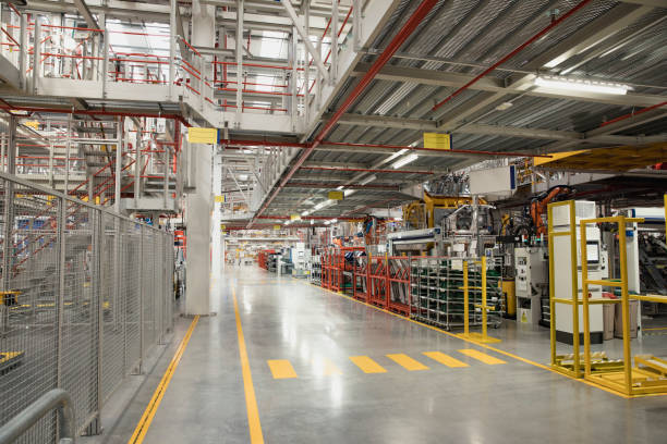 Empty Factory Wide shot of an empty factory. warehouse interior stock pictures, royalty-free photos & images