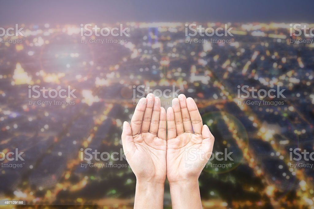 Empty female open human hands prayer with abstract Background stock photo