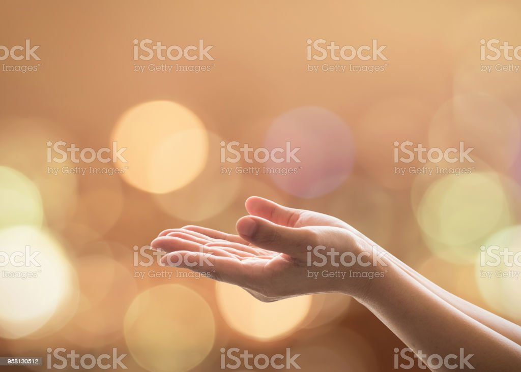 Empty female women open human hand prayer palms up Candle night light natural warm gold lantern bokeh Pray support aid destiny help peace campaign: Holy spirit week: World religion day: Eid mubarak stock photo