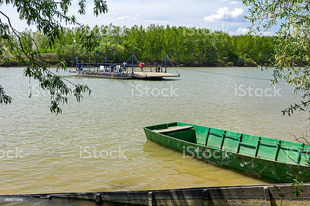 Empty ferry boat is crossing the river. stock photo