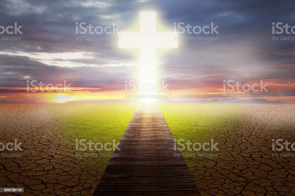 Empty field going to Christian cross stock photo