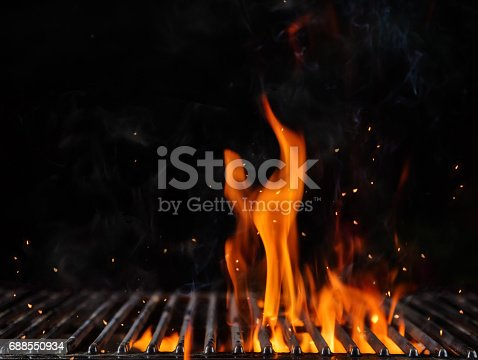 istock Empty flaming charcoal grill with open fire 688550934
