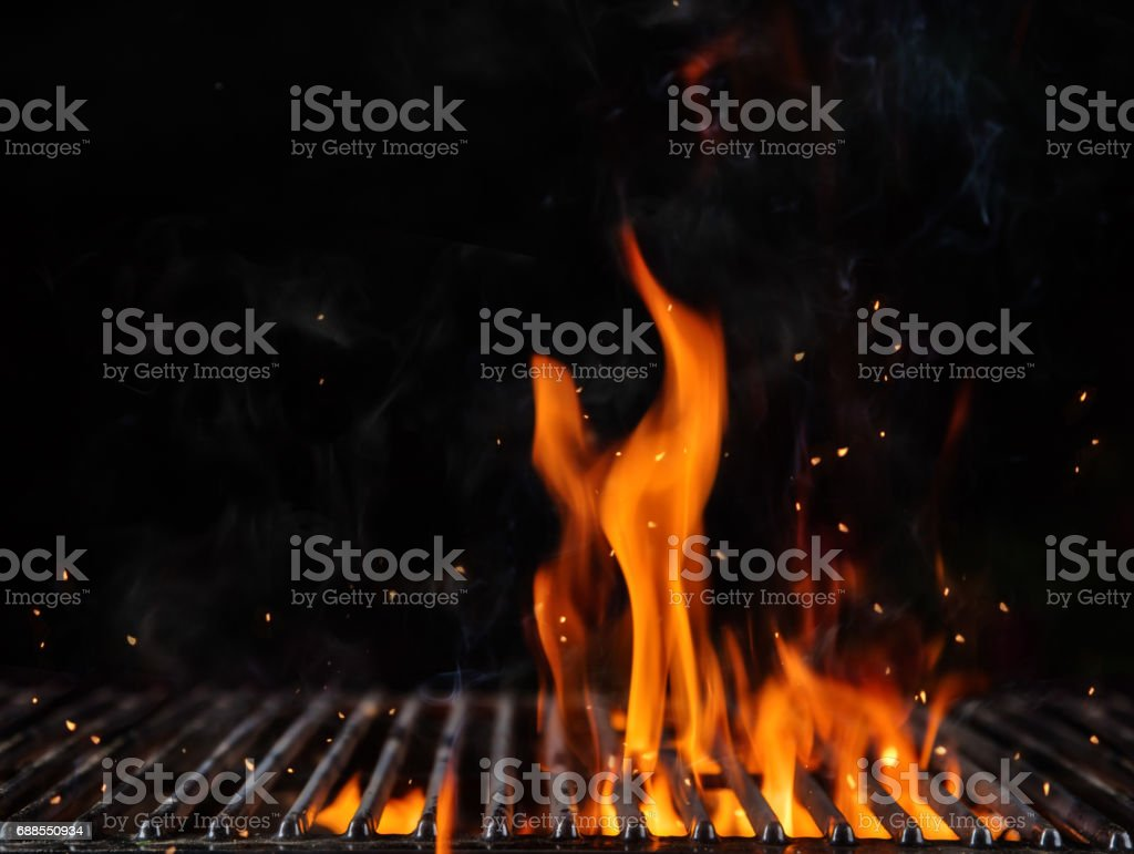Empty flaming charcoal grill with open fire stock photo