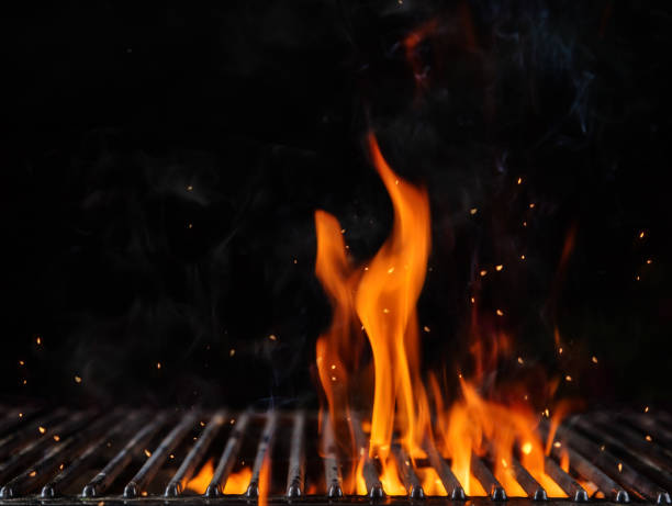 empty flaming charcoal grill with open fire - barbecue grill stock photos and pictures