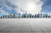 Empty floor and panoramic city skyline with buildings in Shanghai