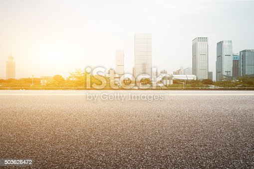 istock empty floor with backdrop on modern cityscape at sunrise time 503626472