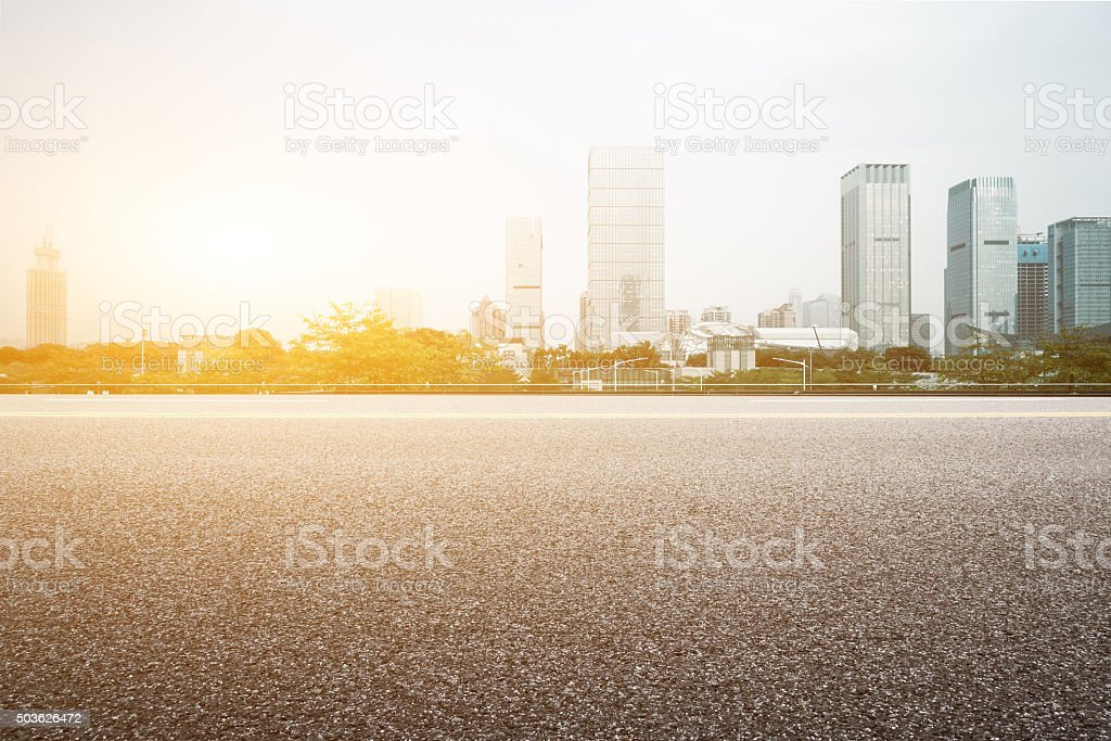 empty floor with backdrop on modern cityscape at sunrise time stock photo