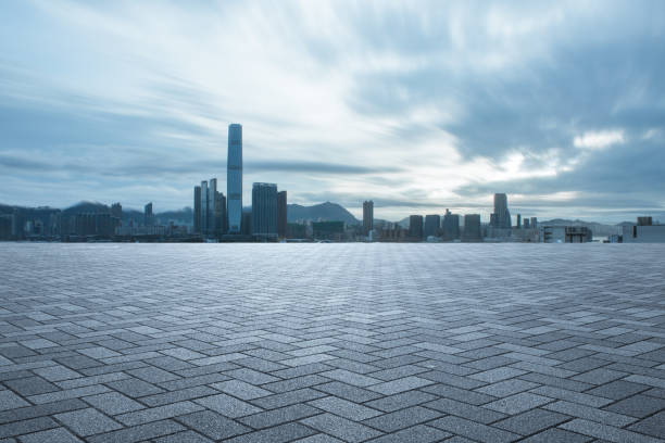empty floor with modern buildings in midtown of modern city in blue sky stock photo