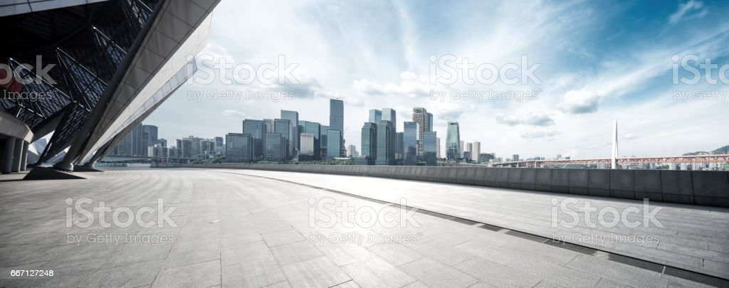 empty floor with modern cityscape and skyline – Foto