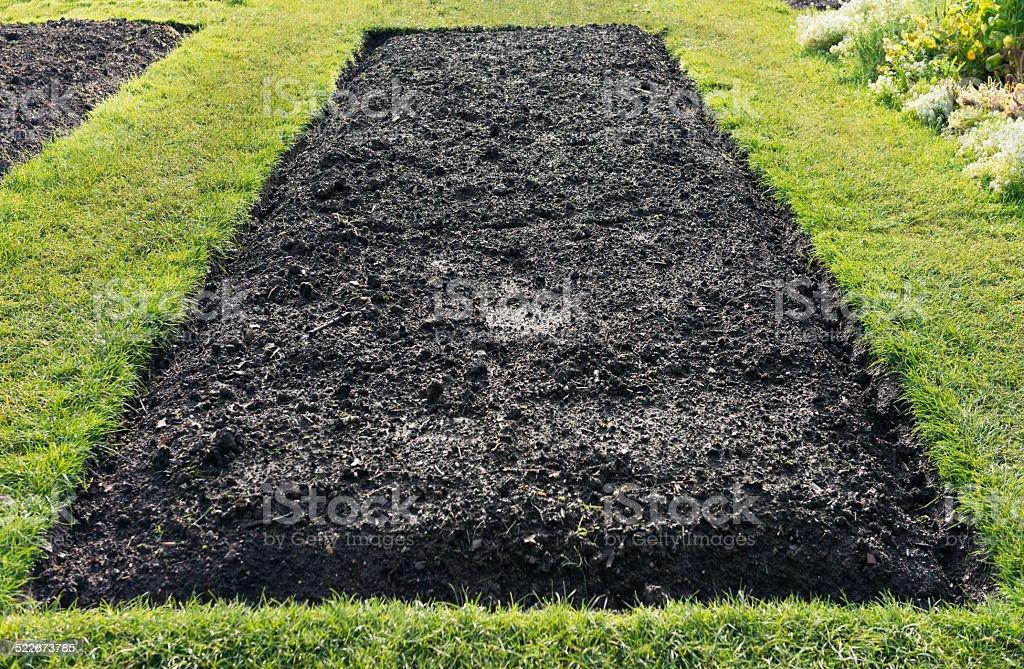 Empty flowerbed stock photo