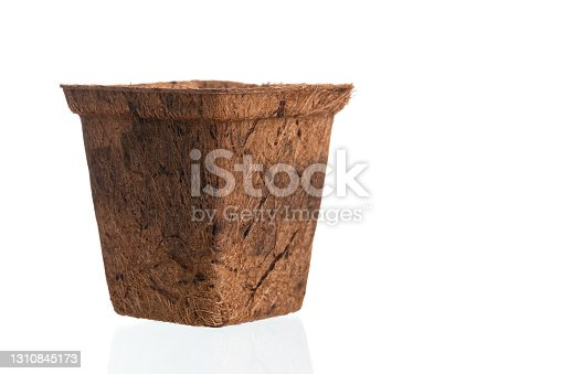 Empty flowerpot made from coconut fiber isolated a on white background