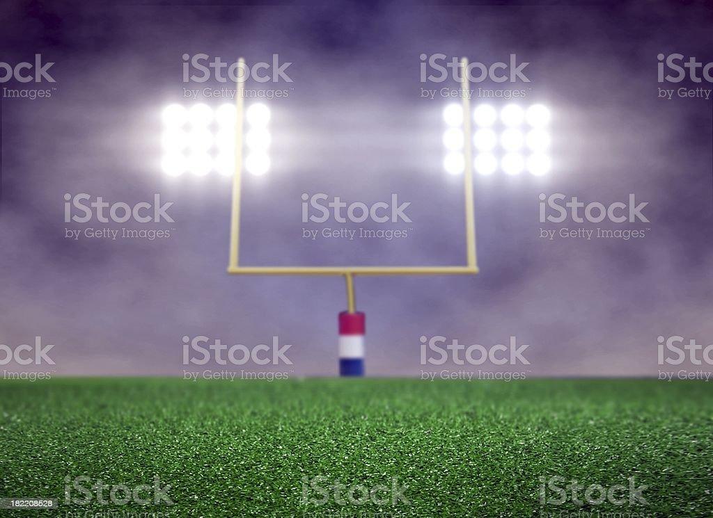 Empty Football Field and Spotlights stock photo