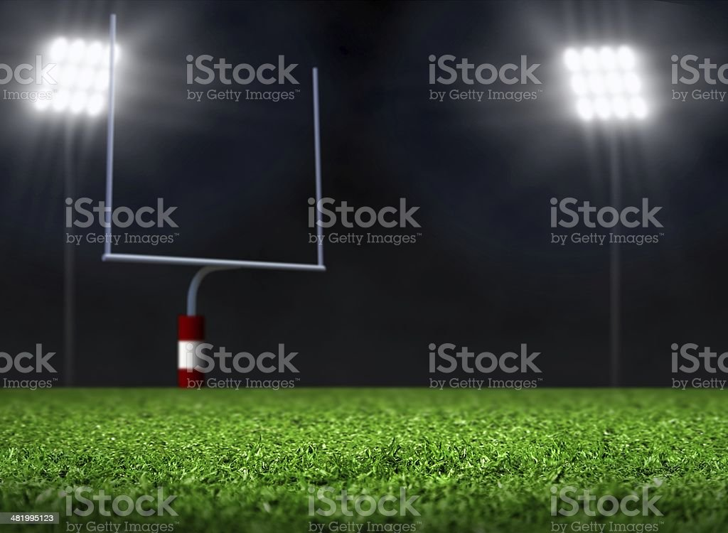 Empty Football Field with Spotlights at Night stock photo