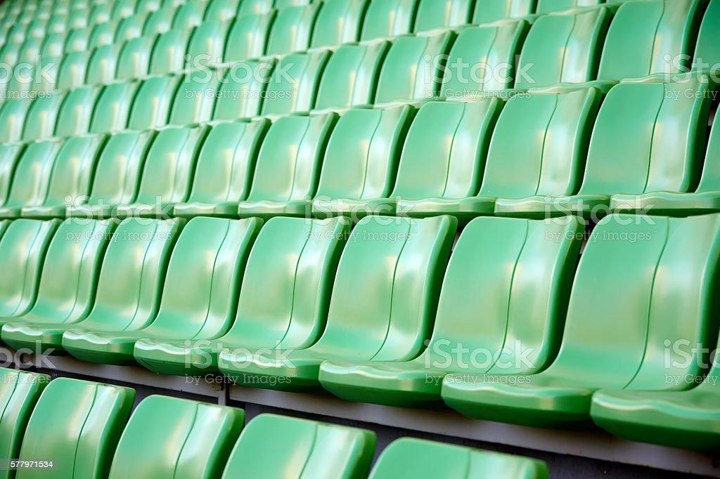 empty football stadium chairs stock photo