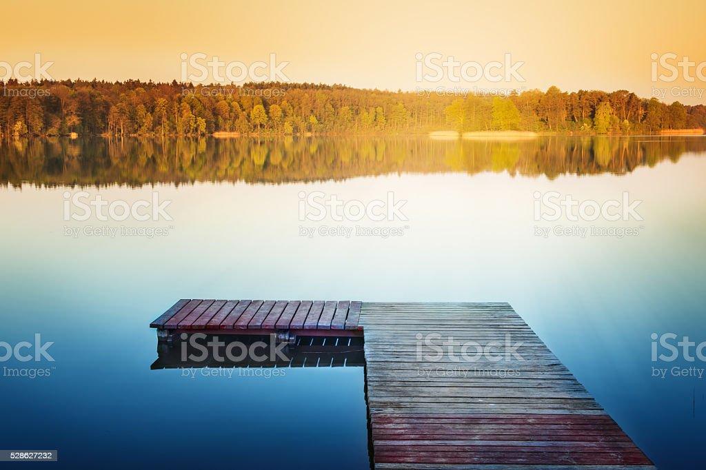 Empty footbridge over the lake stock photo