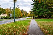 Empty path along a street on a cloudy autumn day. Stockbridge, MA, USA.