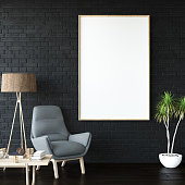 Black picture frame in living room with an armchair