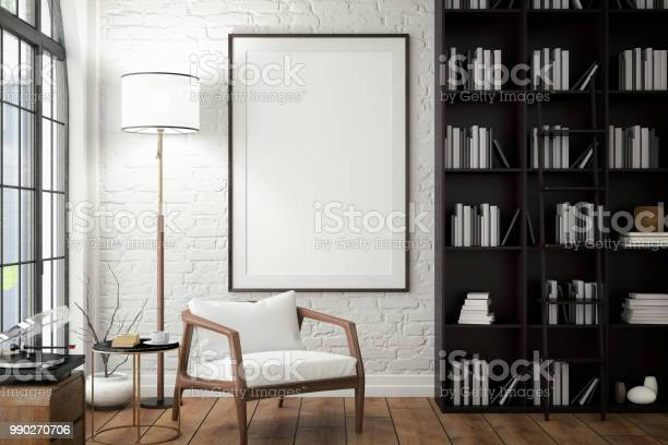 Empty frame on living rooms wall with library picture id990270706?b=1&k=6&m=990270706&s=612x612&h=ys7vhkroswwid a9fv88ibbzwkd4auv2vudk6qmvcbe=