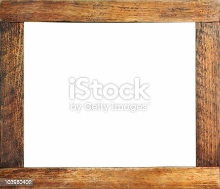 An isolated grungy wooden picture frame with centre isolated