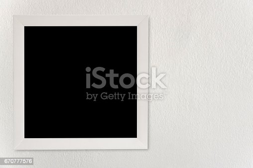 istock Empty frames hang on the white walls. 670777576