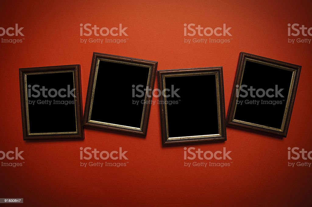 empty frames on red wall royalty-free stock photo