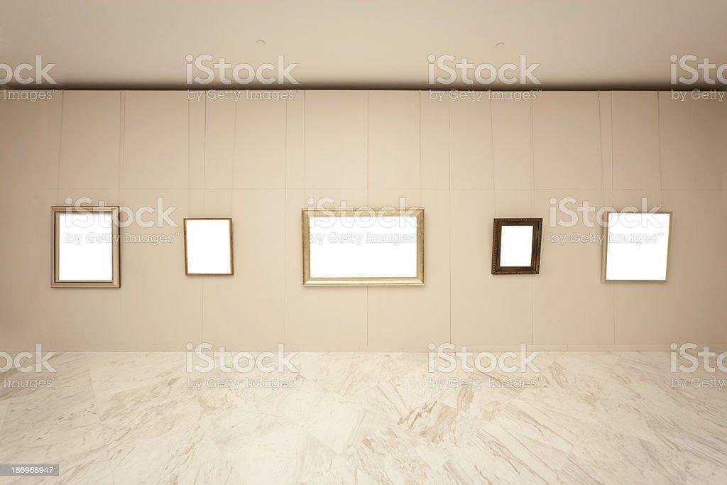 Empty frames on wall stock photo