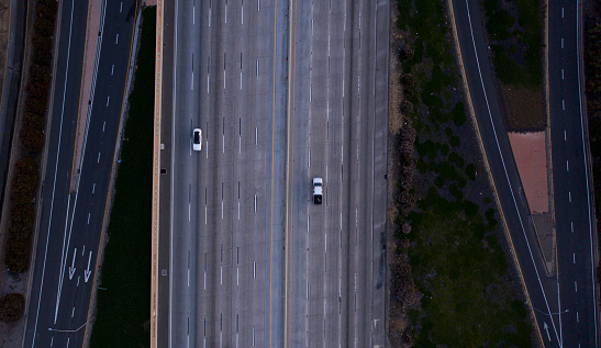 Orange County, California / USA - March 23,  2020:  The 57 Freeway nearly empty at rush hour, with people staying inside in response to the COVID-19 outbreak.