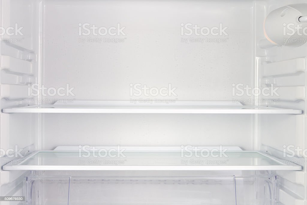 empty fridge as backdrop stock photo