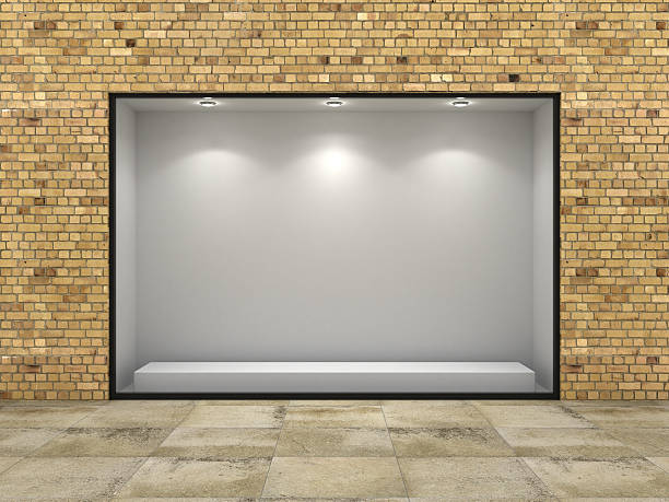 empty ftorefront of shop in bricks wall. - store window stock pictures, royalty-free photos & images