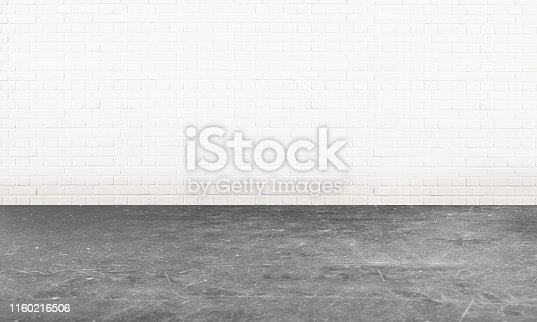 An empty white room with a grey cement floor