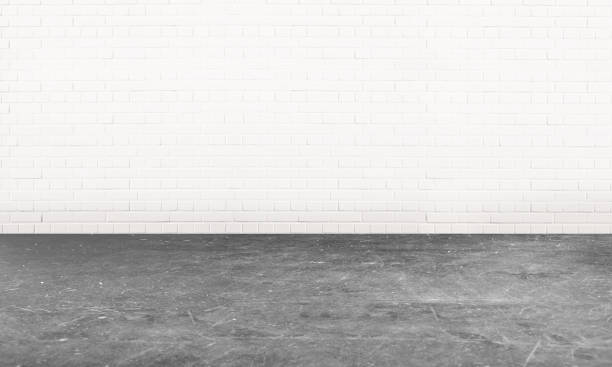 Empty garage room with a cement flooring An empty white room with a grey cement floor cement floor stock pictures, royalty-free photos & images