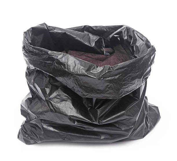empty garbage bag on white background stock photo