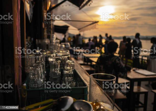 Empty glass at sunset on the table with space for preparing for the picture id1140289958?b=1&k=6&m=1140289958&s=612x612&h=xfsbzwzkancjudd6efpi 1rv8 kgyp39s5abioj1crq=