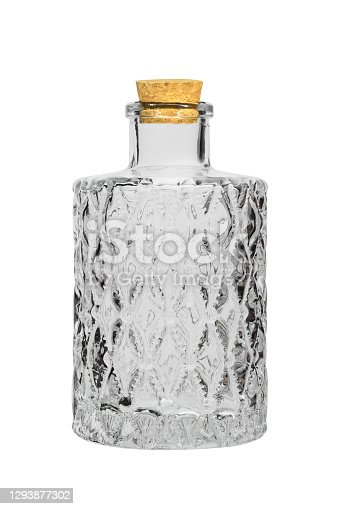 Empty glass decanter bottle, stoppered on white background